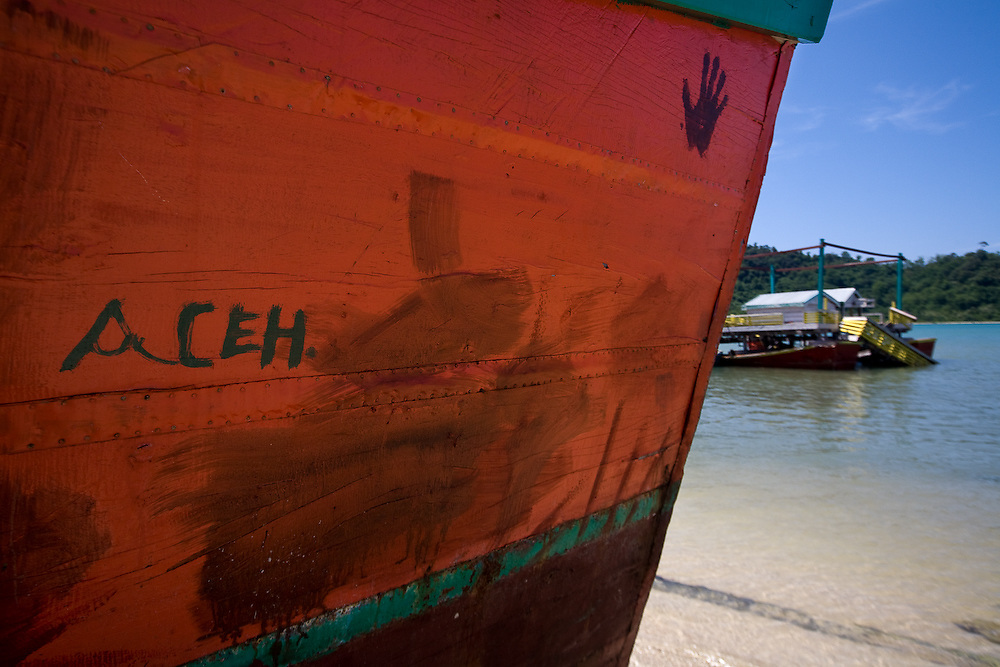 Loong Village near Banda Aceh - Aceh, Indonesia  Nov. 2008. Colorful fishing boats near a newly built fishing community center. The fishing fleet is rapidly rebuilding since the Tsunami when many fishermen were killed, or lost thier boats.