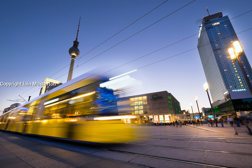 View of Alexanderplatz at night with  tram in Mitte Berlin Germany
