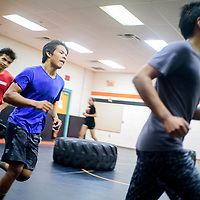 Brother Benny Baca, right, Joey Baca and Koby Baca runs laps around the wrestling room for the cardio portion of the Bengals wrestling workout Thursday at Gallup High School.