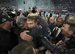 February 4, 2018 - Minneapolis, MN, USA - In a flurry of fireworks and confetti, Philadelphia Eagles coach Doug Pederson, center, and quarterback Nick Foles share a celebratory embrace on Sunday, Feb. 4, 2018, in Minneapolis, Minn. (Credit Image: © Jerry Holt/TNS via ZUMA Wire)