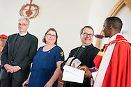 Bishop Emmanuel Makala (right) offers greetings to the congregation along the Rev. Dr. Lawrence R. Rast, Jr., president of Concordia Theological Seminary, Fort Wayne, Ind., Deaconess Amy Rast, associate director of deaconess formation at CTS, and the Rev. Dr. Timothy Quill, professor and director of International Studies at CTS, following a service Sunday, March 15, 2015, at the Evangelical Lutheran Church in Tanzania – South-East of Lake Victoria Diocese's (ELCT-SELVD) Ebenezer Cathedral in Shinyanga, Tanzania. LCMS Communications/Erik M. Lunsford