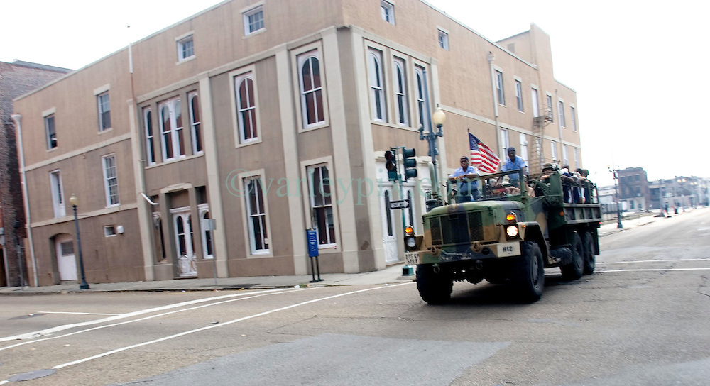 03 Sept  2005. New Orleans, Louisiana. Post hurricane Katrina.<br /> An army truck full of evacuees passes through the Central Business district in New Orleans.<br /> Photo Credit ©: Charlie Varley/varleypix.com
