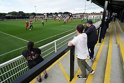 Fans watch the action during the Head for Change and the Solan Connor Fawcett Trust charity match at Spennymoor Town FC, County Durham. Picture date: Sunday September 26, 2021.