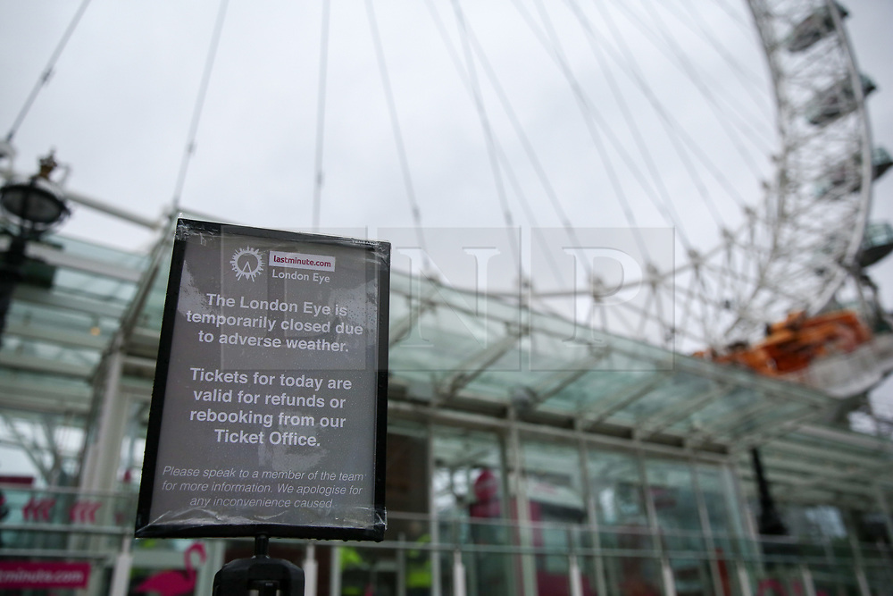 © Licensed to London News Pictures. 09/02/2020. London, UK. A sign outside London Eye saying 'The London Eye is temporary closed due to adverse weather' as the tourist attraction is closed due to Storm Ciara. Heavy rain and strong winds are forecast for the rest of today as the Storm Ciara sweeps across the UK. Photo credit: Dinendra Haria/LNP