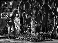 Shadows, fashion and graffiti on Madison Avenue.