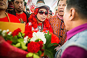 "10 DECEMBER 2012 - BANGKOK, THAILAND:  Red Shirt leaders confront a Pheu Thai official at Pheu Thai offices in Bangkok Monday. The Thai government announced on Monday, which is Constitution Day in Thailand, that will speed up its campaign to write a new charter. December 10 marks passage of the first permanent constitution in 1932 and Thailand's transition from an absolute monarchy to a constitutional monarchy. Several thousand ""Red Shirts,"" supporters of ousted and exiled Prime Minister Thaksin Shinawatra, motorcaded through the city, stopping at government offices and the offices of the Pheu Thai ruling party to present demands for a new charter.        PHOTO BY JACK KURTZ"