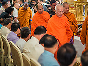 21 AUGUST 2015 - BANGKOK, THAILAND:      Thai Buddhist monks file into a merit making ceremony at Central World to honor the dead from the Erawan Shrine bombing. The Bangkok Metropolitan Administration (BMA) held a religious ceremony Friday for the Ratchaprasong bomb victims. The ceremony started with a Brahmin blessing at Erawan Shrine, which was the target of a bombing Monday night. After the blessing people went across the street to the plaza in front of Central World mall for an interfaith religious service. Theravada Buddhists, Mahayana Buddhists, Muslims, Sikhs, Hindus, and Christians participated in the service. Life at the shrine, one of the busiest in Bangkok, is returning to normal. Friday the dancers and musicians who perform at the shrine resumed their schedules.     PHOTO BY JACK KURTZ