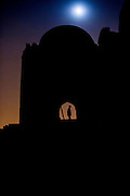 """4th December 2014, New Delhi, India. Moonrise over the ruins of Feroz Shah Kotla as people come to make offerings to Djinns in the hopes of getting wishes granted, New Delhi, India on the 4th December 2014<br /> <br /> PHOTOGRAPH BY AND COPYRIGHT OF SIMON DE TREY-WHITE a photographer in delhi<br /> + 91 98103 99809. Email: simon@simondetreywhite.com<br /> <br /> People have been coming to Firoz Shah Kotla to leave written notes and offerings for Djinns in the hopes of getting wishes granted since the late 1970's. Jinn, jann or djinn are supernatural creatures in Islamic mythology as well as pre-Islamic Arabian mythology. They are mentioned frequently in the Quran  and other Islamic texts and inhabit an unseen world called Djinnestan. In Islamic theology jinn are said to be creatures with free will, made from smokeless fire by Allah as humans were made of clay, among other things. According to the Quran, jinn have free will, and Iblis abused this freedom in front of Allah by refusing to bow to Adam when Allah ordered angels and jinn to do so. For disobeying Allah, Iblis was expelled from Paradise and called """"Shaytan"""" (Satan).They are usually invisible to humans, but humans do appear clearly to jinn, as they can possess them. Like humans, jinn will also be judged on the Day of Judgment and will be sent to Paradise or Hell according to their deeds. Feroz Shah Tughlaq (r. 1351–88), the Sultan of Delhi, established the fortified city of Ferozabad in 1354, as the new capital of the Delhi Sultanate, and included in it the site of the present Feroz Shah Kotla. Kotla literally means fortress or citadel."""