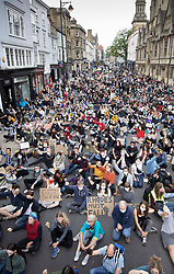 © Licensed to London News Pictures. 09/06/2020. Oxford, UK. Campaigners sit outside Oriel College at Oxford University, where they are calling for the removal of a statue of controversial imperialist Cecil Rhodes. Black Lives Matter protesters recently pulled down a statue of slave trader Edward Colston in Bristol town centre, following the death of George Floyd in the USA . Photo credit: Peter Macdiarmid/LNP