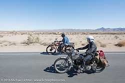 Paul Jung of Germany riding the 1915 Harley-Davidson entry from W and W Cycles of Wurzburg flies by Kevin Naser of Nebraska on his 1916 Indian during the Motorcycle Cannonball Race of the Century. Stage-14 ride from Lake Havasu CIty, AZ to Palm Desert, CA. USA. Saturday September 24, 2016. Photography ©2016 Michael Lichter.
