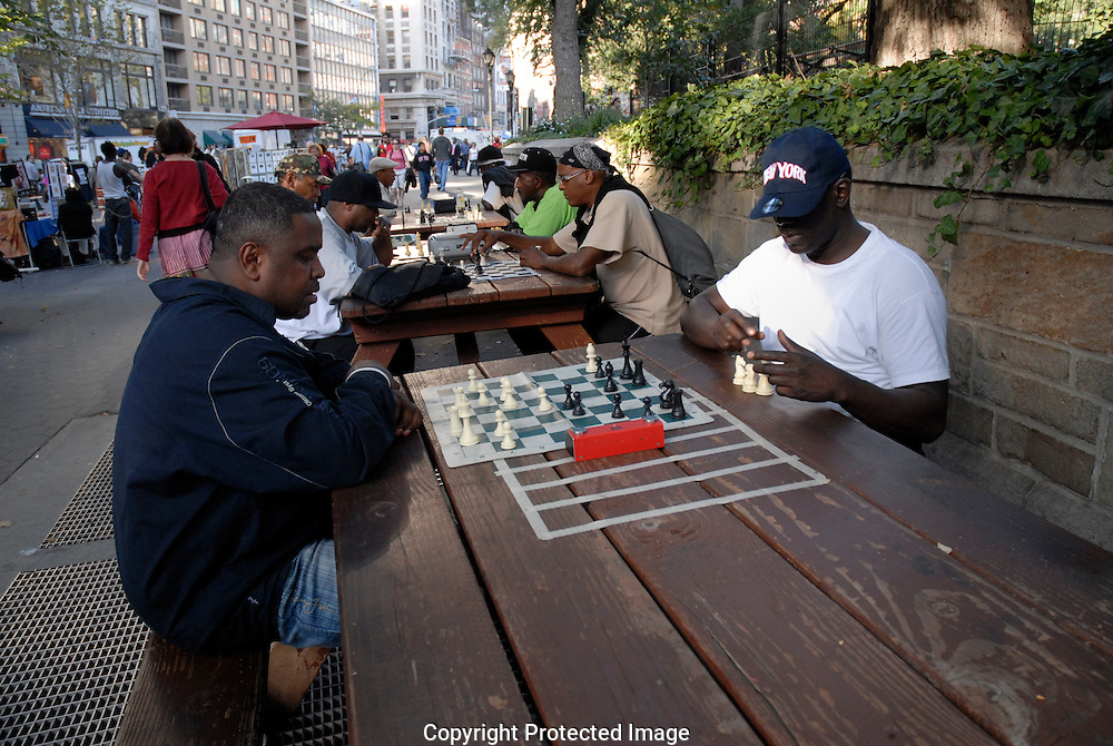 Group of men playing chess in New York city