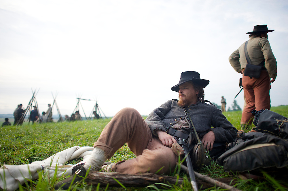 Geoff Roecker, from Brooklyn, New York City, of the Constitution Guard, lounges in camp the morning of the final day of the Blue Gray Alliance reenactment during events marking the 150th anniversary of the Battle of Gettysburg, in Gettysburg, Pennsylvania June 30, 2013.