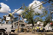 18 AUGUST 2020 - CEDAR RAPIDS, IOWA: A crew of IBEW electrical workers from across the country works on a destroyed power pole in Cedar Rapids. Cedar Rapids was the state's hardest hit city by the derecho that roared across Iowa last week. City officials said the damage left by the derecho was more extensive than the 2008 flood that destroyed much of its downtown. City residents are reporting that almost every home was damaged in the storm, many businesses were closed, and up to half of the city's tree canopy was destroyed. A week after the storm, more than 40,000 homes were still without power. A spokesman for Alliant Energy said the utility has replaced as many power poles in one week that they normally replace in 8 months. On Monday, President Trump approved a $4 billion emergency declaration for Iowa to aid in derecho recovery.    PHOTO BY JACK KURTZ