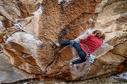 Climber at Hueco Tanks State Park & Historic Site, El Paso, Texas. USA.