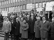 Thurles Sugar Workers Protest..1986..16.01.1986..01.16.1986..16th January 1986..After a rationionalisation plan was invoked the Irish Sugar Company which had already closed the sugar factory at Tuam now turned its attention to the factory at Thurles. The soon to be affected workers staged a protest against the cuts at the headquarters of The Sugar Company at Earlsfort Terrace,Dublin..The workers were supported by trade union officials and had much cross party support from Dail Eireann and The Seanad. Included among the protestors were,.Hugh Byrne TD,Sean Treacy TD, Senator Des Hanifin,Sean Byrne TD,Senator Mick Smith,.Maura Scully, Chairperson,Thurles,UDC, Cllr John O'Connor,David Moloney TD, Cllr Tom Condon, Pat Rabbitte, National General Secretary.IT&GWU,John Ryan TD,Leas Ceann Comhairle of the Dail,Senator Michael Ferris,Duputy Leader of the Senate,Labour spokesman on agriculture,Ned Brennan,Cllr Harry Byrne and Michael Kennedy TD...Photograph shows the workers being joined by supporters from Dail Eireann,The Seanad and the Unions.