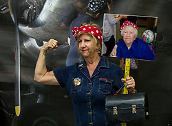 Oct.14, 2017 - Ypsilanti, Michigan, U.S. -  A woman poses for a photo in front of a backdrop during an attempt at Eastern Michigan University to set  a Guinness World Record for Most Rosie the Riveters. Some 3,755 women, men and children were officially counted, shattering the previous record held by Richmond, California. The world record effort brings attention to the campaign to renovate the Willow Run factory, home of the original Rosie the Riveter during WWII.(Credit Image: © Brian Cahn via ZUMA Wire)