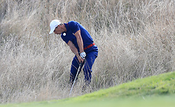 Team Europe's Thorbjorn Olesen attempts to get on the fourteenth green during the Fourballs match on day one of the Ryder Cup at Le Golf National, Saint-Quentin-en-Yvelines, Paris.