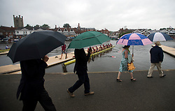© London News Pictures. 29/06/2012.  Henley-on-Thames, UK.  People protecting themselves from the rain with umbrellas  on day 3 of Henley Royal Regatta on the River Thames in Henley on Thames, Oxfordshire on June 29, 2012. Photo credit: Ben Cawthra/LNP