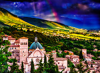 """""""Heavens erupting with rainbows over the Cathedral of San Rufino Assisi""""…<br /> <br /> This image is perhaps one of the most blessed and miraculous of my Italian journey.  Upon arrival early that day in Assisi, I began taking photos the second I parked at Hotel Giotto just inside the walls in the foothills of Assisi. Perhaps Saint Francis arranged the dramatically perfect skies and coordinated every encounter. Beginning at the Basilica of Saint Francis, every second of the climb to the top of the mountain to the fortress Rocca Maggiore, a new surprise awaited around every corner.  Upon my final steps to the top at almost sunset, the clouds parted and the low sun brightened as a slight mist of rain came down.  Looking back over my shoulder, I was mesmerized at the appearance of this first of eventually two rainbows shining down behind the Duomo of Saint Rufino. I was able to take a few horizontal and vertical images of the rainbows just as the sun began it's decent below the horizon. My Italian journey was truly blessed by the hand of God. This image is a vertical panorama combining two vertical and one horizontal image."""
