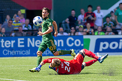 May 13, 2018 - Portland, OR, U.S. - PORTLAND, OR - MAY 13: Portland Timbers Sebastián Blanco chips the ball over Seattle Sounders goal keeper to score the only goal of the match in the last minutes of the Portland Timbers 1-0 victory over the Seattle Sounders on May 13, 2018, at Providence Park in Portland, OR. (Photo by Diego Diaz/Icon Sportswire) (Credit Image: © Diego Diaz/Icon SMI via ZUMA Press)