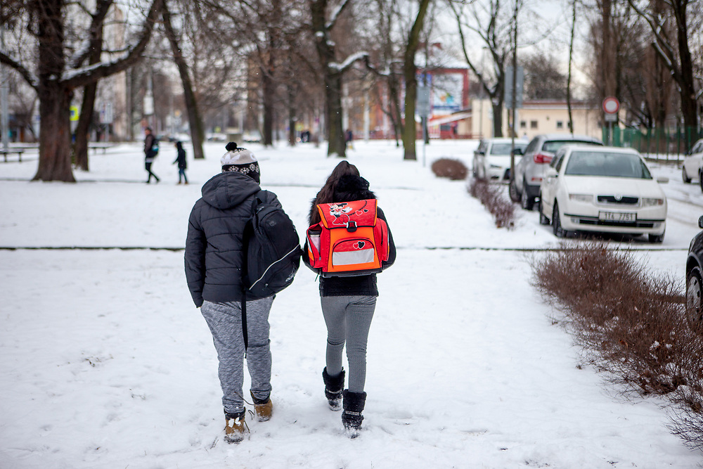 """Antonin Gabor (9, left) and Rachel Klemparova (9) after leaving school in a close by park. Antonin visits the 3rd class, Rachel the 4th. Both are visiting the """"Nadrazni"""" school in Ostrava where Roma and non Roma children are educated together."""