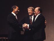 President Jimmy Carter, President Anwar Sadat, and Prime Minister Menachem Begin during toast at a state dinner on April 8, 1980.<br /> <br /> Photograph by Dennis Brack<br /> bb45