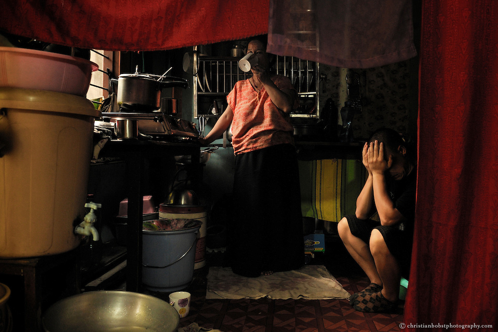 A tibetan refugee family in their home in the so called Tibetan settlement in Manali, India, 2009