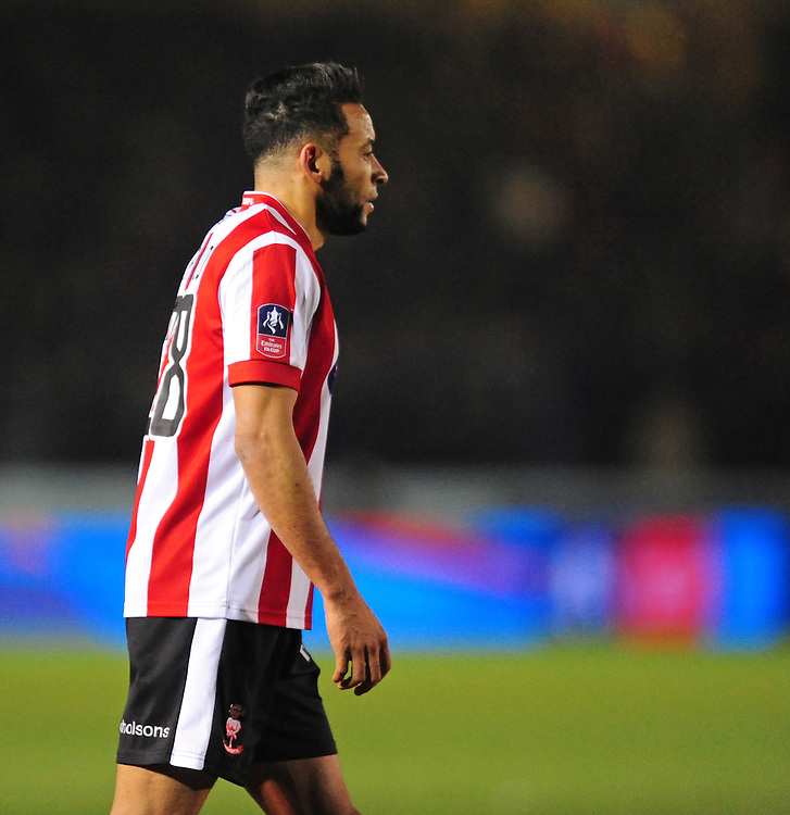 The Emirates FA Cup badge on the side of the match shirt worn by Lincoln City's Nathan Arnold<br /> <br /> Photographer Chris Vaughan/CameraSport<br /> <br /> Emirates FA Cup Third Round Replay - Lincoln City v Ipswich Town - Tuesday 17th January 2017 - Sincil Bank - Lincoln<br />  <br /> World Copyright © 2017 CameraSport. All rights reserved. 43 Linden Ave. Countesthorpe. Leicester. England. LE8 5PG - Tel: +44 (0) 116 277 4147 - admin@camerasport.com - www.camerasport.com