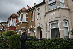 © Licensed to London News Pictures. 28/07/2021. London, UK. A police officer guards a residential property on Stanley Road in Enfield, north London. Police officers responded to calls of concern relating to the address on Stanley Road in Enfield, at approximately 16:00hrs on 27 July and found a man in his 40s dead. A woman has been arrested and is believed to have known the man. Photo credit: Dinendra Haria/LNP