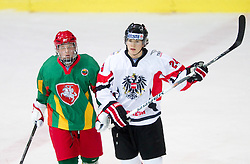 Clemens Unterweger (R) of Austria  during the ice hockey match between National teams of Lithuania (LTU) and Austria (AUT) at 2011 IIHF World U20 Championship Division I - Group B, on December 12, 2010 in Ice skating Arena, Bled, Slovenia.  (Photo By Vid Ponikvar / Sportida.com)