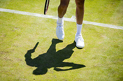 July 2, 2018 - London, United Kingdom - 180702 The feet, racket and shadow of a tennis player during day 1 of Wimbledon on July 2, 2018 in London..Photo: Ludvig Thunman / BILDBYRN / kod LT / 35496 (Credit Image: © Ludvig Thunman/Bildbyran via ZUMA Press)