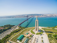 Aerial view of Sanctuary of Christ the King overlooking Lisbon and 25 de Abril Bridge connecting Lisbon and Almada.