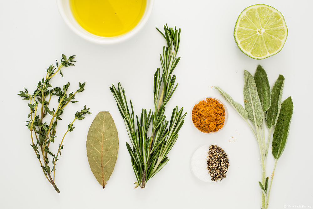 Turmeric lends its anti-inflammatory properties to the mix in this visual recipe for zesty Turmeric and Lime Roast Chicken.  Ingredients include turmeric, lime, thyme, bay leaf, rosemary, salt, pepper, sage, and olive oil.