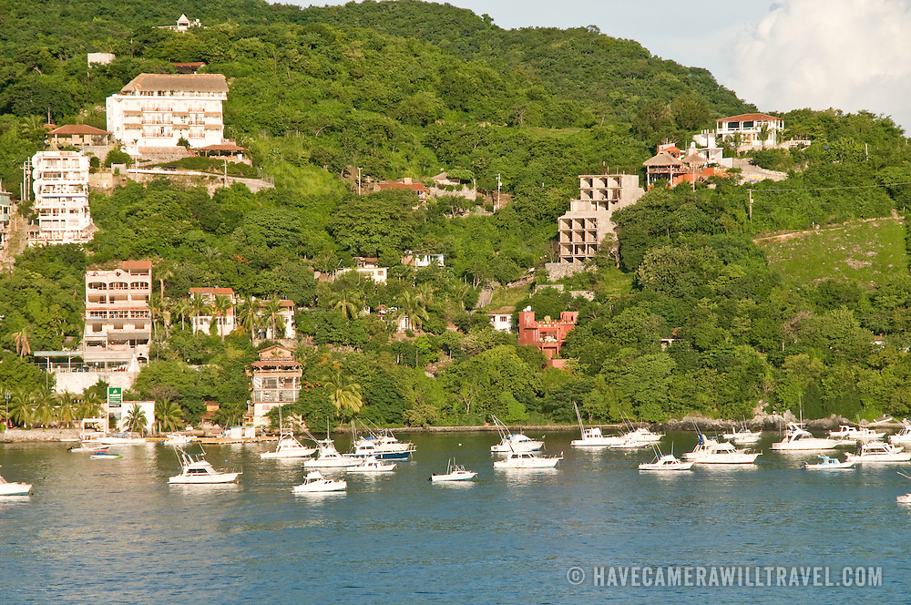 Boats anchored at harbor in the bay at Zihuatanejo, Mexico.