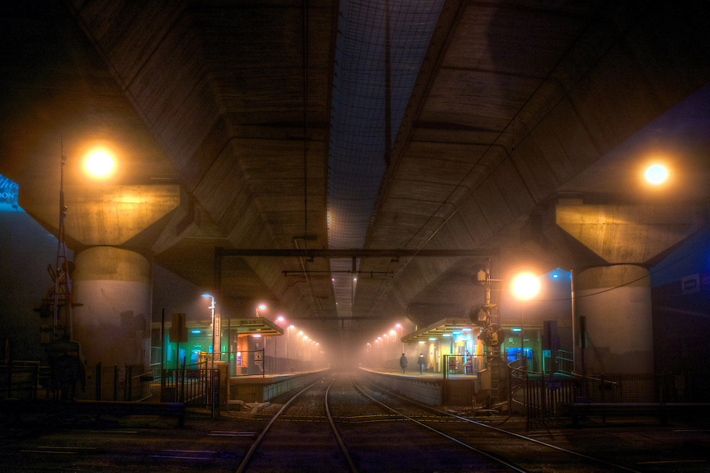 Scary Railway Stations at night. About 9:30. Two figures on the platform at Macaulay railway station under heavey fog. The station is built under the CityLink Tollway. Pic By Craig Sillitoe CSZ/The Sunday Age/The Age iPad App.28/06/2011 This photograph can be used for non commercial uses with attribution. Credit: Craig Sillitoe Photography / http://www.csillitoe.com<br /> <br /> It is protected under the Creative Commons Attribution-NonCommercial-ShareAlike 4.0 International License. To view a copy of this license, visit http://creativecommons.org/licenses/by-nc-sa/4.0/.