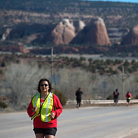 DeAndra Wagner-Morris reaches the half way point in the Sweetheart 5k run course hosted by the Tséhootsooí Medical Center in Fort Defiance Thursday. The event brought in about 200 participants.
