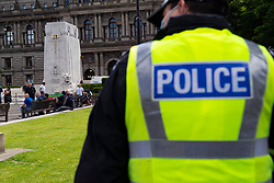 Glasgow, Scotland, UK. 20 June, 2020. Anti facist and pro refugee demonstration and protest today in George Square, Glasgow. Large police and mounted police presence all around the square. Loyalist group guarding war memorial were surrounded by cordon of police. Men guarding the war memorial cenotaph surrounded by police.   Iain Masterton/Alamy Live News