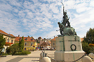 Dobo Statue with Eger Castle behind - Hungary .<br /> <br /> Visit our HUNGARY HISTORIC PLACES PHOTO COLLECTIONS for more photos to download or buy as wall art prints https://funkystock.photoshelter.com/gallery-collection/Pictures-Images-of-Hungary-Photos-of-Hungarian-Historic-Landmark-Sites/C0000Te8AnPgxjRg