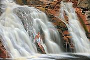 Boy in waterfall. Mary Ann Falls. MOdel released <br /> Cape Breton Highlands National Park<br /> Nova Scotia<br /> Canada