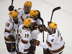 November 17, 2017 - Minneapolis, MN, USA - Teammates celebrated with Minnesota Golden Gophers defenseman Steve Johnson (4) after Johnson scored a goal in the second period against Harvard on Friday, Nov. 17, 2017, at the 3M Arena at Mariucci in Minneapolis. (Credit Image: © Aaron Lavinsky/TNS via ZUMA Wire)