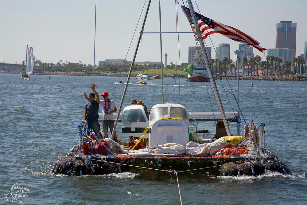 """On Sunday June 1, the raft named """"Junk""""  left Long Beach for it's 2100 mile voyage to Hawaii to bring attention to the plastic marine debris (nicknamed the plastic soup) accumulating in the North Pacific Gyre. The raft was designed and will be sailed by Dr. Marcus Eriksen of the Algalita Marine Research Foundation, and Joel Paschal, it is constructed from 15,000 plastic bottles, an airplane fuselage, discarded fishing nets and a solar generator. The raft was towed for two and a half days to near San Nicholas Island, about 65 mile of the coast of California, so it could catch favorable winds for it's trip. The tow boat was the ORV Alguita, captained by Charlie Moore of the Algalita Marine Research Foundation, the man credited for first discovering the plastic soup in the Gyre over 12 years ago."""