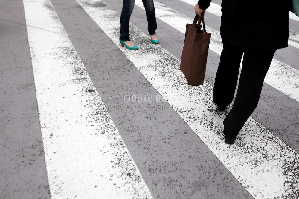 businessman and woman on a zebra crossing