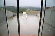 outdoor garden chair on roof terrace on a rainy and gray day France Languedoc