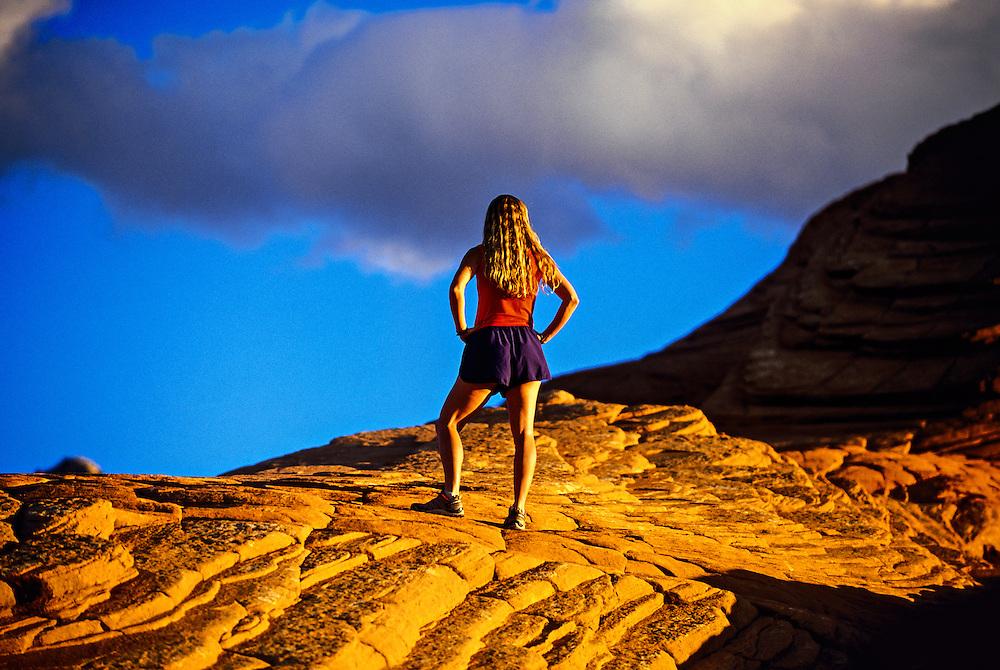 Woman runner, Snow Canyon State Park, near Ivins (near St. George), Utah USA
