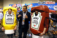 Characters at the Berkshire Hathaway company Kraft Heinz booth pose with a reporter at the shareholder shopping day as part of the Berkshire Hathaway annual meeting weekend in Omaha, Nebraska May 5 2017. REUTERS/Rick Wilking