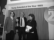11/01/1985.01/11/1985.11th January 1985.The Aer Lingus Young Scientist Exhibition at the RDS Dublin ..Ronan McNulty, (left) of Rathfarhnam, Dublin, the Aer Lingus Young Scientist of the Year 1985, with Norman Scott, the Northern Ireland Minister for Education and Gemma Hussey, T.D, Minister for Education.