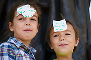 Two small children with post it notes attached to their foreheads which say  This Is Worst Then Brexit at the Global Climate Strike on 20th September, 2019 in London, United Kingdom. Inspired by teenage climate activist Greta Thurnburg, millions of workers and students around the world are striking  to take part in climate strike protests to demand governments take action.