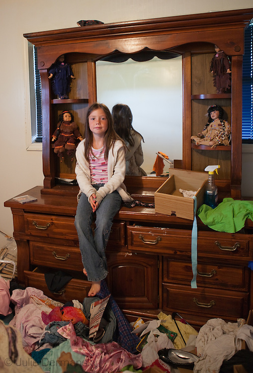 Girl in her grandparents home in Point-aux Chene, LA. Her family are all part of the Pointe-au-Chien Indian tribe. Shrimping and crabbing is how all the embers of her family made a living. Faith has been working for her cousin Grace Welch, but is no longer able since shrimp and crab season were closed on May 29th ,2010. SHe is worried about not being able to eat seafood ever again.