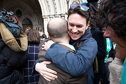© Licensed to London News Pictures. 27/02/2020. London, UK. Friends of the Earth staff and supporters celebrate outside the High Court after judges ruled that the planned expansion of Heathrow Airport was illegal over climate change. Photo credit: Rob Pinney/LNP