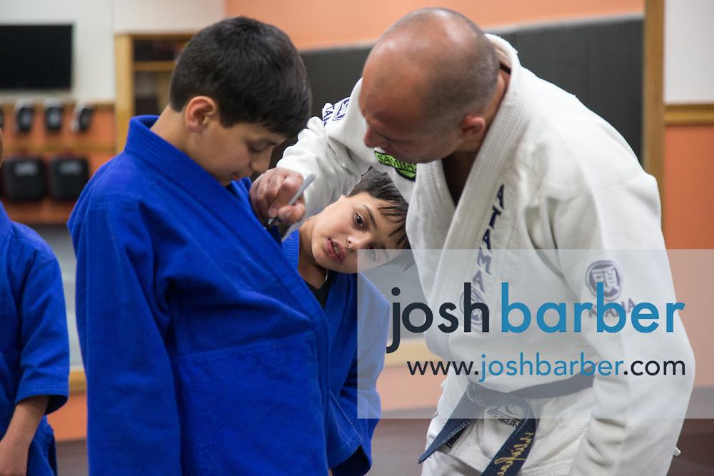 AJ Khatemi, KJ Khatemi and Royce Gracie during a jiu-jitsu lesson at US Blackbelt Academy on Thursday, March 26, 2015 in Laguna Niguel, Calif. (Photo/Josh Barber)